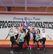 Gymnastics coaches bringing back the 80's