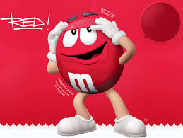 red m&m (jester archetype) posed