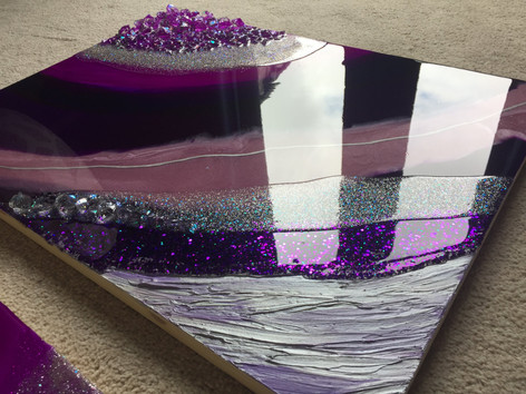 The client wanted something in purple and silver tones to match the decor of her living room and provided.