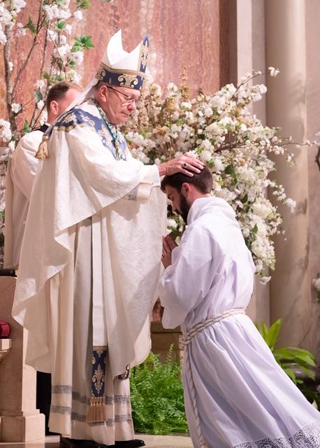 Rev Mr JJ annointing by bishop