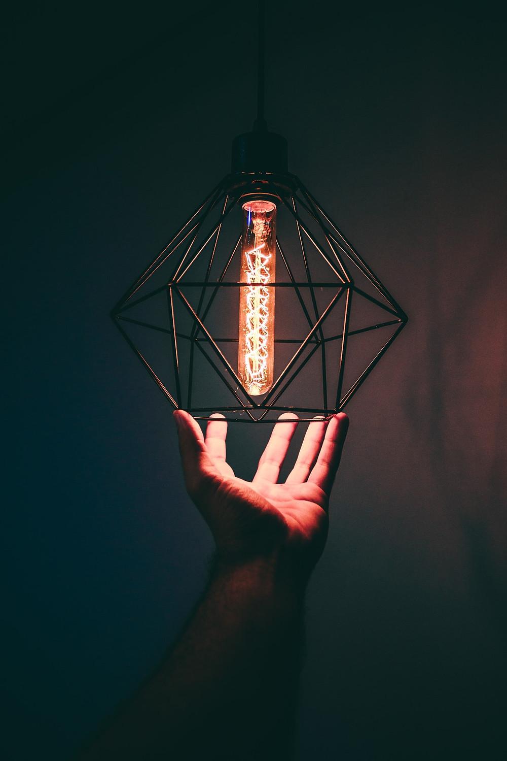 man holding led light fixture