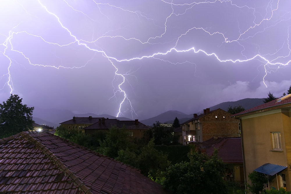 lighting striking a house