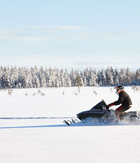 Snowmobile plowing