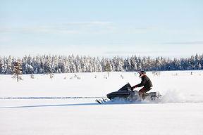 Snowmobile plowing