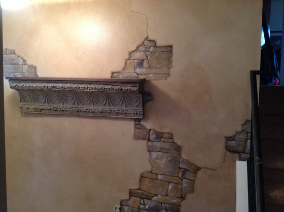 Painted antiqueplaster exposing stone