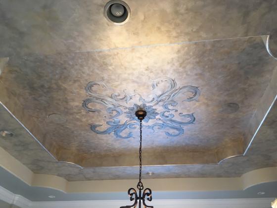 Moody metallic dining room ceiling
