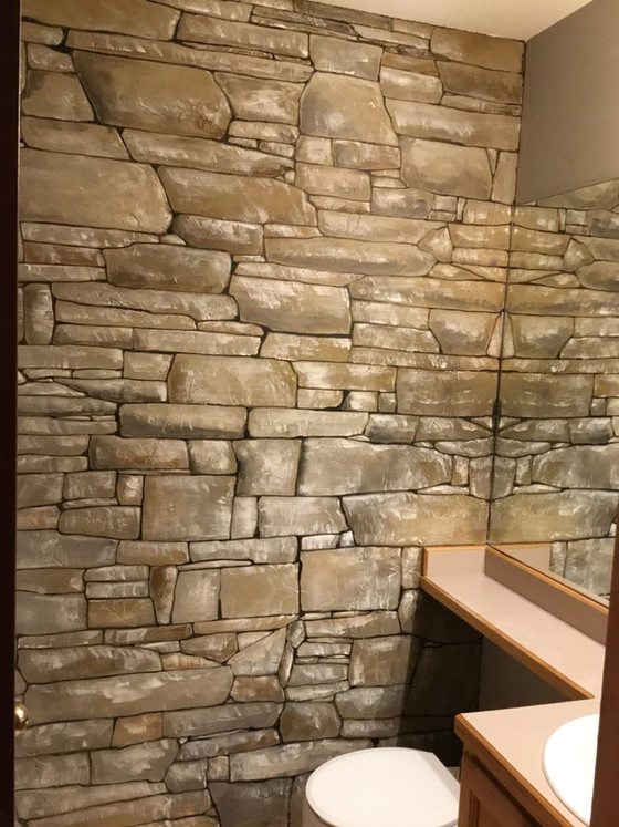 """Stone"" wall created for a friendlier, cozier bathroom"