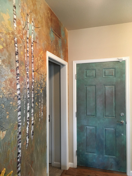 Faux copper door compliments colorful entry mural