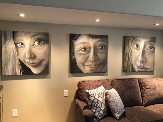 Whimsical portraits center the family's lounge