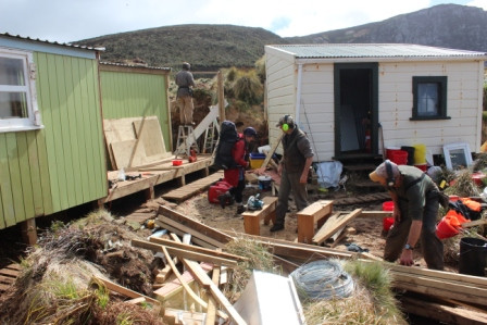 Crews Help Rebuild House Damaged by Heavy Rains