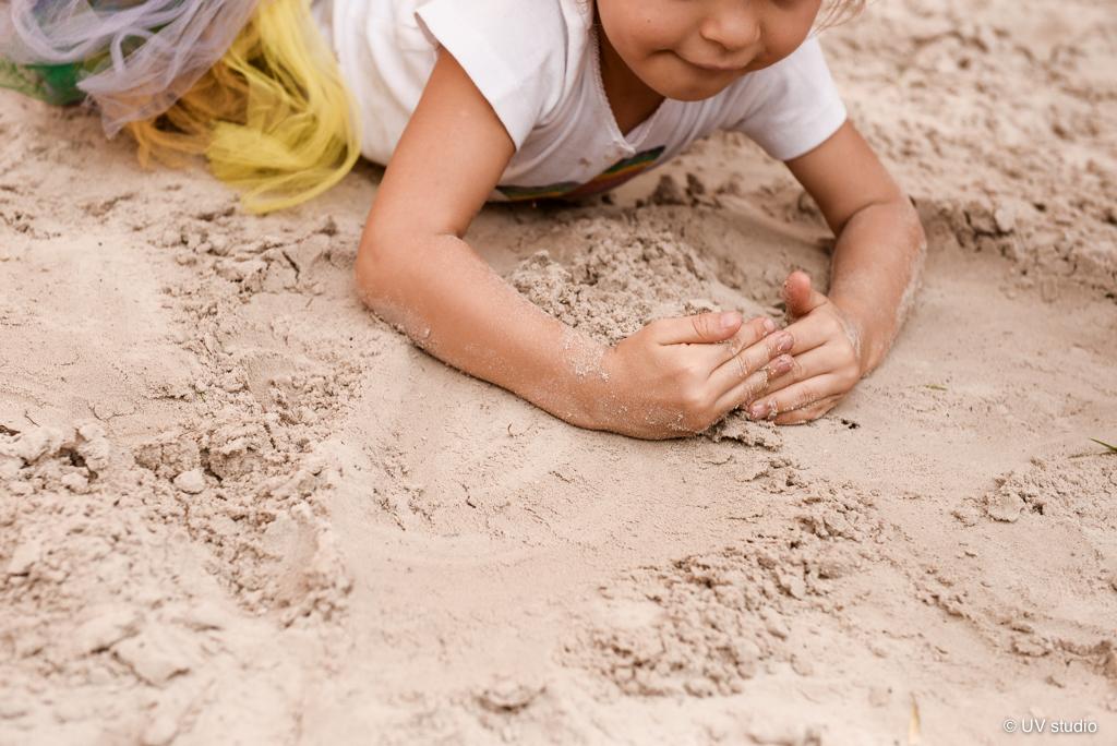 Mãos na areia