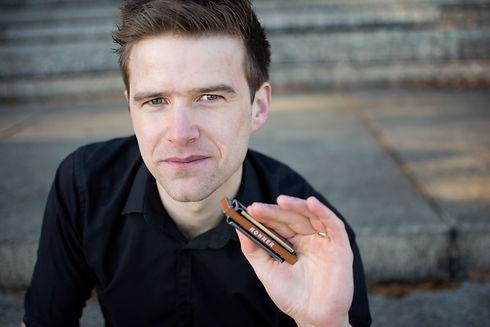 Liam Ward harmonica press shot