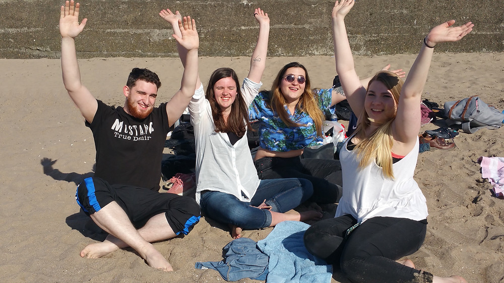 (Group of sun seekers decided to have a bit of unusual fun at Ayr beach) - Even raised the hands for the picture.