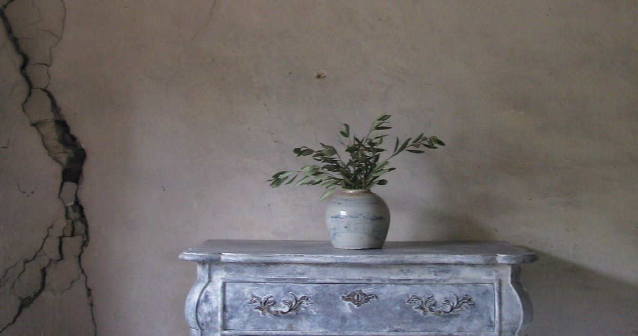 Antique Table with a potted plant