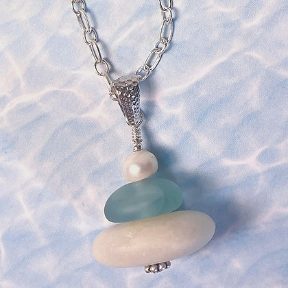 White stone, Glass and a Pearl Necklace II