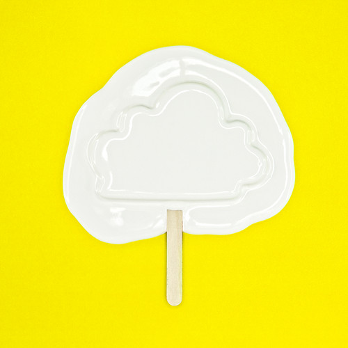 Melting cloud ice cream_yellow backgroun