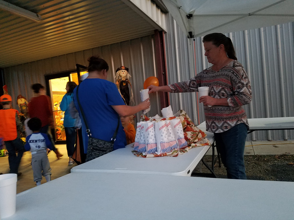 Mom handing out Kettle Corn at Faith Baptist Chruch Event
