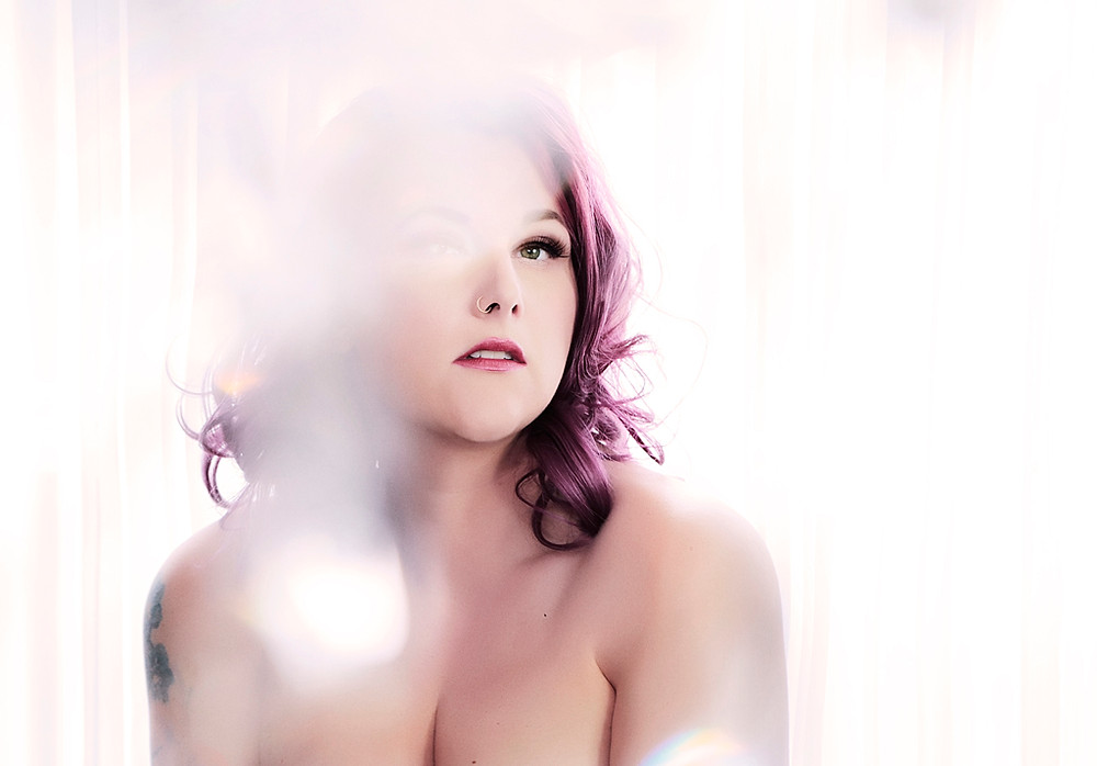 Fall in love with yourself with a boudoir photo shoot. Natalie Kita Boudoir in Delaware.