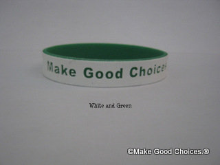 Wrist Band White With Green Letters