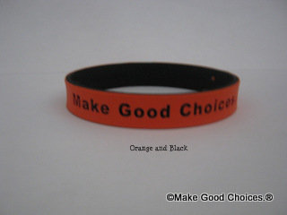 Wrist Band Orange With Black Letters