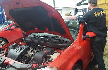 Car being repaired at stop and go instant oil change in Vermont