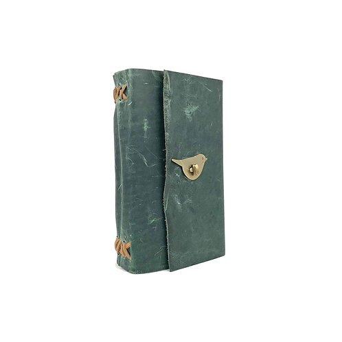 Main image of hand-bound green leather journal with brown accents. Unique brass coloured bird shaped closure.