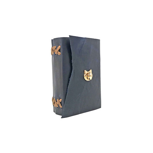 Main image of small blue leather journal. Hand-bound with brown accent. Natural edge leather on front flap. Gold cat closure.
