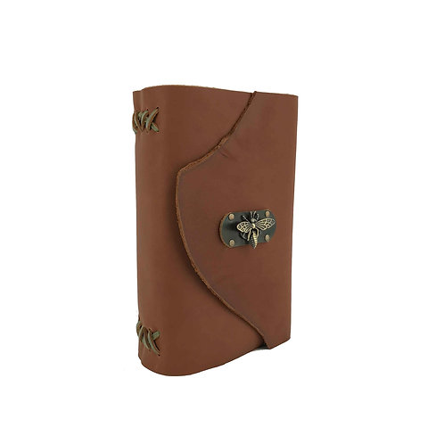 Brown leather bound journal with green accents and bee closure