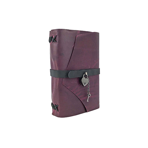 purple leather journal with black hand stitched binding and heart lock and key closure