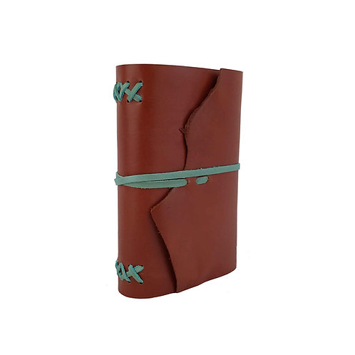 Burnt orange leather journal with turquoise binding and ties. Tropical colour palette.