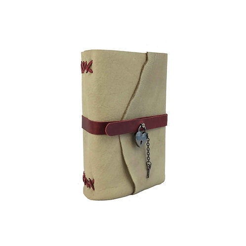 Natural beige coloured bison leather journal with red accents. Has a working black heart lock and key closure.