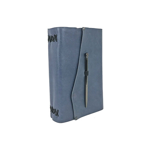 Light blue leather journal hand-bound with black accents. Tiny black decorative skull rivets and skull pen closure.