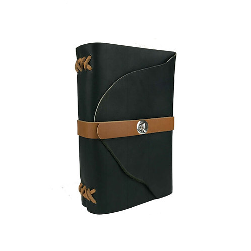 Main image of large dark green journal with tan leather binding and closure strap. Silver oval turning clasp closure.