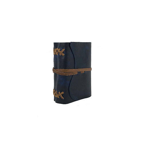 Main image of small blue journal hand-bound with brown leather ties. Natural edge of leather on front flap.