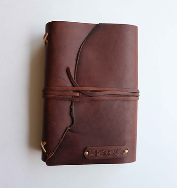Brown leather bound journal personalized with stamped initials