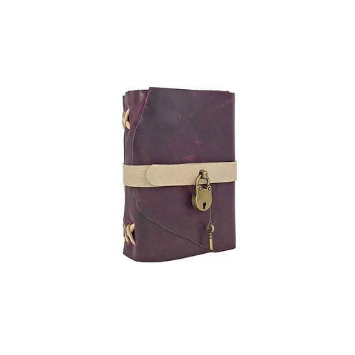 Main image of small hand-bound purple leather journal with beige accents. Brass lock and key closure.
