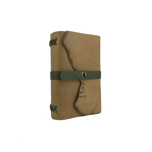 Main image of rustic tan leather journal with sage green accents and antique brass oval turning clasp closure. Natural edges.