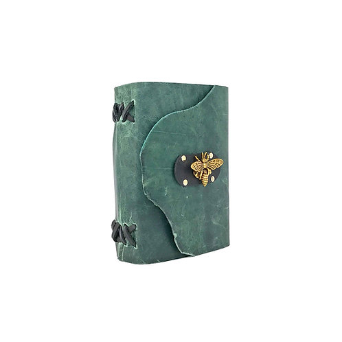Main image of small green leather journal with natural edge on front flap, hand-stitched black binding and gold bee closure.