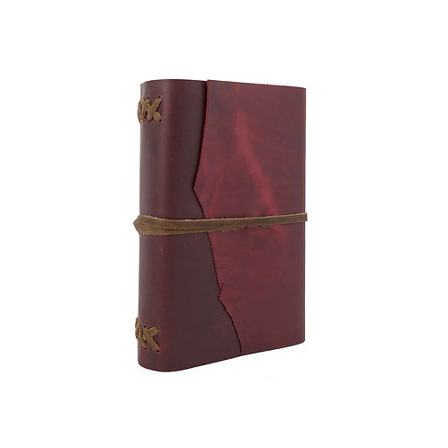 red leather journal with brown hand stitched binding and simple tie closure