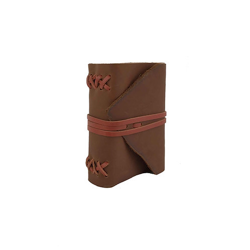 Main image of small brown leather journal with burnt orange leather binding and closure ties. Natural leather edge front flap
