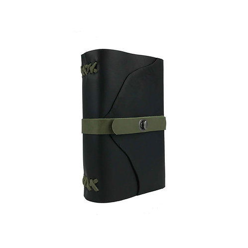 Main image of large black leather journal with sage green accents. Pewter oval turning clasp and cool skull rivets.