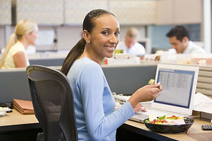 businesswoman-in-cubicle-with-laptop-eat