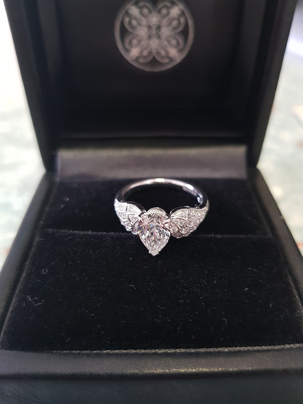 The custom designed ring that I got for my fiancé. The angel wing was inspired by some images I found on the internet and brought to life by expert designers.