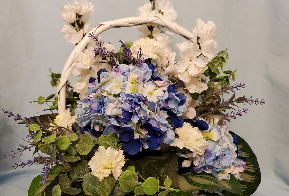 White wicker basket with blue and white flowers