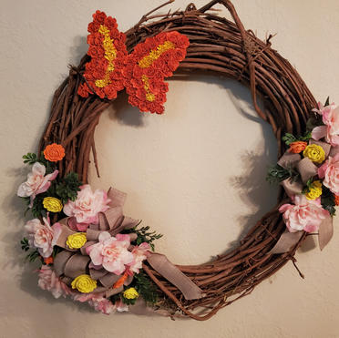 Grapevine wreath with butterflies and flowers