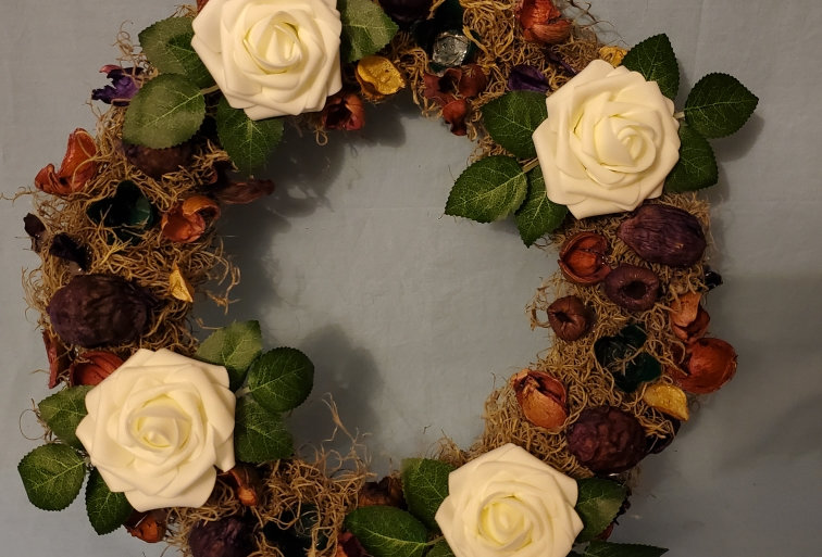 White roses and dried flower candle ring