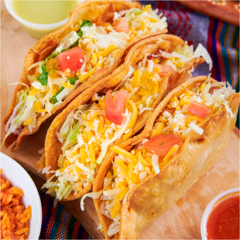 Rudy's award winning Crispy Tacos are a large corn tortilla filled with shredded beef or shredded chicken, lettuce & cheese.
