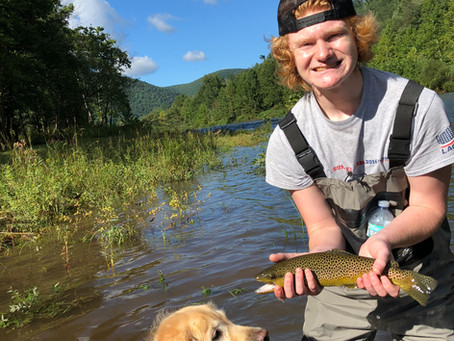 Blake with this amazing Brown Trout and Brookie. High water no problem, stripping streamers.