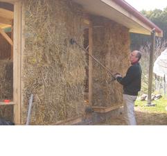 Brush cutting the strawbale walls.png