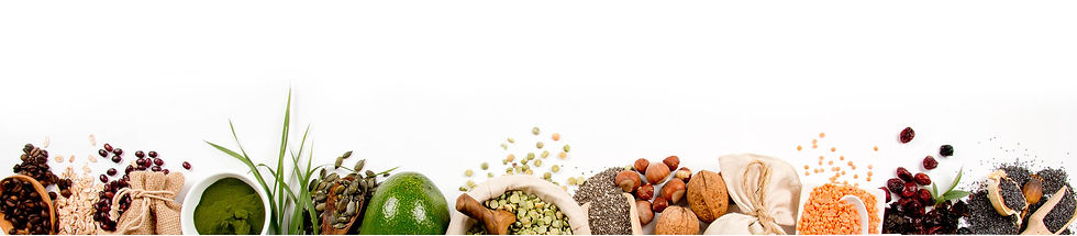 White background with lower quarter displaying fresh avocado, bowl of lentils, seeds and whole hazel